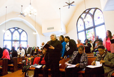 Attendees sing a hymn during a memorial service for Dr. Martin Luther King Jr. at St. Luke's United Church of Christ in Jeffersonville on Monday afternoon. Staff photo by Christopher Fryer