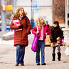 Heather Young, New Albany, walks along East Market Street with her daughters Bekah, 10, center, and Karis, 9, in downtown New Albany on Thursday afternoon. Staff photo by Christopher Fryer