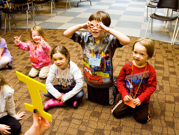 From left, Kelly Heavner, 2, New Albany, Abilene Lynch, 4, Floyds Knobs, Alex Heavner, 6, New Albany, and Ryan Heavner, 4, New Albany, participate in an activity during the Reading Rock Stars program in the Applegate Room at the New Albany-Floyd County Public Library on Tuesday afternoon. The program is designed to help children develop their literacy skills before they start school. Staff photo by Christopher Fryer