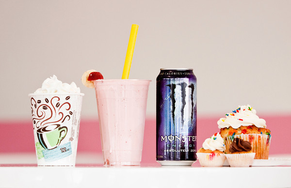 A vanilla hot chocolate, a banana-strawberry-Monster smoothie, an Absoloutely Zero Monster Energy drink, and Sweets by Morgan cupcakes sit on a table inside Swirlz Yogurt and Coffee, located at 2784 Meijer Drive in Jeffersonville. Staff photo by Christopher Fryer