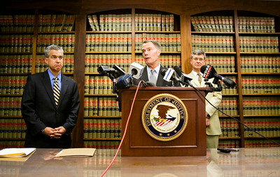 U.S. Attorney Joseph Hogsett, center, speaks about a grand jury indictment surrounding Clark County Sheriff Daniel Rodden and his alleged involvement with a prostitute during a press conference at the Lee H. Hamilton Federal Building in downtown New Albany on Tuesday afternoon. Staff photo by Christopher Fryer