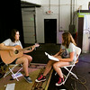 Rachel May, New Albany, left, works with Julia Coward, 13, Jeffersonville, during the Rachel May Studios and New Albany Production House's Jam Camp in New Albany on Thursday afternoon. A total of six participants attended the week-long camp for teenagers where they worked on songwriting, musicianship, artist development, and recording. Staff photo by Christopher Fryer