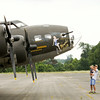 "Pat Coons, left, Jeffersonville, holds his grandson Spencer Coons, 2, New Albany, while he talks to mechanic Jon Eads, San Diego, about the B-17 bomber on display at the Clark County Airport along U.S. 31 as part of The Liberty Foundation's 2014 Salute to Veterans tour. The plane, which dates back to 1945, was used in the 1990 film ""Memphis Belle"", and is one of only 12 B-17 bombers in the world that are still able to fly. Staff photo by Christopher Fryer"