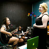 Erica Oakley, 14, Louisville, left, and Brianna Montgomery, 12, Jeffersonville, accompany Katie McKay, 17, Jeffersonville, while she rehearses a song during the Rachel May Studios and New Albany Production House's Jam Camp in New Albany on Thursday afternoon. A total of six participants attended the week-long camp for teenagers where they worked on songwriting, musicianship, artist development, and recording. Staff photo by Christopher Fryer