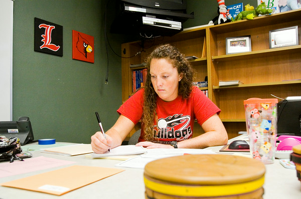 Jamie Collins, Scottsburg, works on lesson plans in her classroom at Scribner Middle School on Monday afternoon. Collins was the recipient of a $100 gift card to the Your Educational Supply Store from the New Albany-Floyd County Consolidated School Corp. Education Foundation. All first-time teachers in the school system received a gift card to help them set up their classrooms. Staff photo by Christopher Fryer