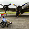 """World War II veteran Kenneth Payton, 93, and his son-in-law, David Gibson, both of Louisville view the exterior of a B-17 bomber on display at the Clark County Airport along U.S. 31 as part of The Liberty Foundation's 2014 Salute to Veterans tour. The plane, which dates back to 1945, was used in the 1990 film """"Memphis Belle"""", and is one of only 12 B-17 bombers in the world that are still able to fly. Staff photo by Christopher Fryer"""