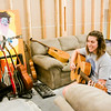 Rachel May, New Albany, gives Julia Coward, 13, Jeffersonville, not pictured, a congratulatory smile after they finished a recording during the Rachel May Studios and New Albany Production House's Jam Camp in New Albany on Thursday afternoon. A total of six participants attended the week-long camp for teenagers where they worked on songwriting, musicianship, artist development, and recording. Staff photo by Christopher Fryer