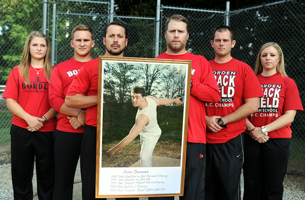 Left to Right: Borden track alumni title holders Carson Casey, Brett Williams, Toby Cheatham, Brandon Cook, Logan Chanley and Lindsey Cook each followed in the shot put and discus legacy left by Sam Sumner (pictured) from '87-'90.  Staff photo by Tyler Stewart