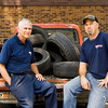 "Mike Anderson, Floyds Knobs, left, and Derrick Faulkenburg, Greenville, sit on the tailgate of ""Old Red"", a 1971 Chevy truck, in front of Faulkenburg Automotive along Paoli Pike in Floyds Knobs. Anderson operated the business as Mike's Tire Service from April of 1981 until Monday, July 21 when ownership was officially transferred to Faulkenburg. ""Old Red"" came with the business, and is used to haul old tires to the junk yard. Staff photo by Christopher Fryer"