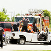 Emergency officials work the scene of a two-car, injury accident involving a truck and an SUV that occurred in front of Theatair X at about 2:22 p.m. along U.S. 31 on Monday in Clarksville. The accident happened while both vehicles were traveling northbound and the SUV struck the truck from behind while the driver was turning left into the adult theater. Arthur Kovalevsky, the driver of the SUV, was arrested after fleeing the scene and disposing of drug paraphernalia. Kovalevsky also admitted to law enforcement that he was driving under the influence of marijuana and spice. Staff photo by Christopher Fryer