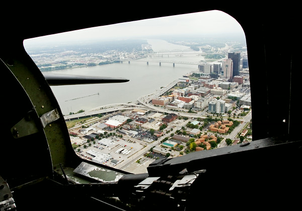 "Downtown Louisville and southern Indiana are framed in a waist gunner window of a B-17 bomber during a media flight as part of The Liberty Foundation's 2014 Salute to Veterans tour. The plane, which dates back to 1945, was used in the 1990 film ""Memphis Belle"", and is one of only 12 B-17 bombers in the world that are still able to fly. Staff photo by Christopher Fryer"