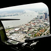 """Downtown Louisville and southern Indiana are framed in a waist gunner window of a B-17 bomber during a media flight as part of The Liberty Foundation's 2014 Salute to Veterans tour. The plane, which dates back to 1945, was used in the 1990 film """"Memphis Belle"""", and is one of only 12 B-17 bombers in the world that are still able to fly. Staff photo by Christopher Fryer"""