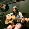 Julia Coward, 13, Jeffersonville, goes through a sound check before a recording session during the Rachel May Studios and New Albany Production House's Jam Camp in New Albany on Thursday afternoon. A total of six participants attended the week-long camp for teenagers where they worked on songwriting, musicianship, artist development, and recording. Staff photo by Christopher Fryer