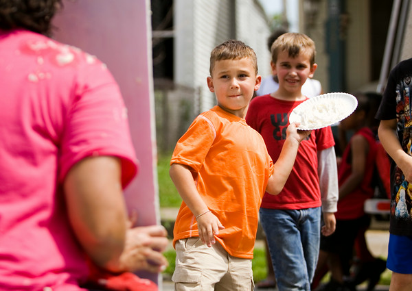 Bryden Stafford, 5, New Albany, takes aim at the pie throwing booth during the inaugural Back to School Block Party in front of the Ed Endres Boys and Girls Club along Ekin Avenue in New Albany on Wednesday afternoon. The event was put on by the Boys and Girls Club of Kentuckiana and the Floyd County Bar Association, and free school supplies were available, as well as refreshments, activities and games. Staff photo by Christopher Fryer