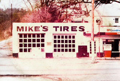 An old photograph of Mike's Tire Service is pictured at Faulkenburg Automotive along Paoli Pike in Floyds Knobs. Mike Anderson operated the business from April of 1981 until Monday, July 21 when ownership was officially transferred to Derrick Faulkenburg. Staff photo by Christopher Fryer
