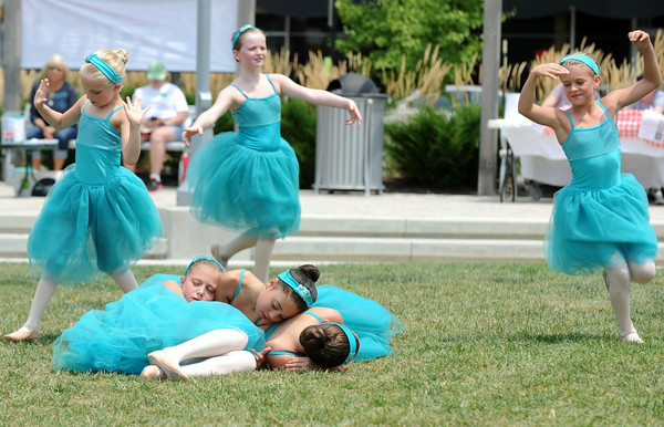 "Motion Studio's junior company performs ""A Midsummer Night's Dream"" in celebration of National Dance Day at the Bicentennial Park in New Albany Saturday. The junior company, ages 7-11, have been working with Motion Studios on the ballet routine for the past four months. <br /> Staff photo by Tyler Stewart"