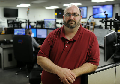 Brad Meixell, Executive Director of the Clark County Emergency Communications Center, oversees the daily operations of the county's central 911 call center in Sellersburg. Meixell is working to consolidate the county's dispatchers into one center as mandated by recent Indiana changes.  Staff photo by Tyler Stewart