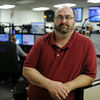 Brad Meixell, Executive Director of the Clark County Emergency Communications Center, oversees the daily operations of the county's central 911 call center in Sellersburg. Meixell is working to consolidate the county's dispatchers into one center as mandated by recent Indiana changes. <br /> Staff photo by Tyler Stewart
