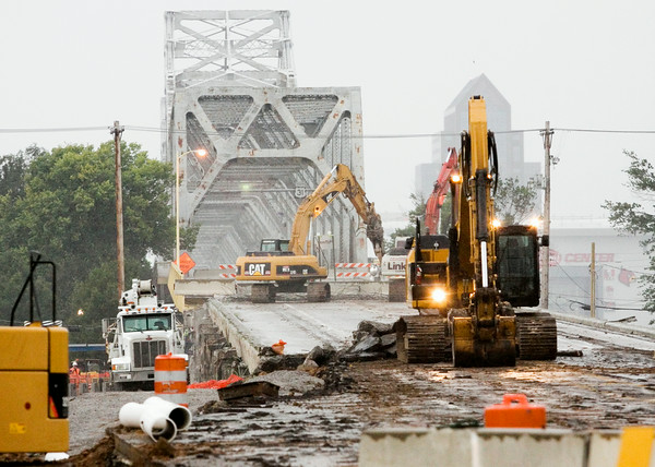 Construction crews work to dismantle the Indiana approach to the Clark Memorial Bridge in Jeffersonville on Tuesday morning. The bridge will be completely shut down for about six weeks. Staff photo by Christopher Fryer