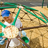 Aaron Bilbro, New Albany, with Arnold Painting out of Floyds Knobs, applies a fresh coat of paint to a jungle gym at Green Valley Elementary School in New Albany on Monday afternoon. The company donated the labor and the New Albany Sherwin-Williams along Rolling Creek Drive donated the paint for two pieces of playground equipment at the school in preparation for the start of the school year later this week. Staff photo by Christopher Fryer