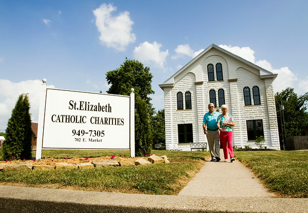 Lawrence, left, and Barbara Very, Sellersburg, exit the Holy Trinity Rectory, which houses offices for St. Elizabeth Catholic Charities, while touring the recently renovated building as part of an open house at St. Elizabeth's campus along Market Street in New Albany on Monday afternoon. Staff photo by Christopher Fryer