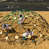 From left, Jeremy Cooley, New Albany, Aaron Bilbro, New Albany, and Micah Arnold, Floyds Knobs, all with Arnold Painting out of Floyds Knobs, work to apply a fresh coat of paint to a jungle gym at Green Valley Elementary School in New Albany on Monday afternoon. The company donated the labor and the New Albany Sherwin-Williams along Rolling Creek Drive donated the paint for two pieces of playground equipment at the school in preparation for the start of the school year later this week. Staff photo by Christopher Fryer
