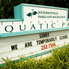 The sign at the front entrance to the Jeffersonville Aquatic Center is pictured along Middle Road on Monday afternoon. The facility closed last Thursday after a positive strain of E. Coli was found in the water. Water fowl are believed to be responsible for contaminating the water, and several measures have been made to repel the animals from the facility. Staff photo by Christopher Fryer