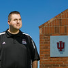 Indiana University Southeast Athletic Director Joe Glover is pictured next to the Koetter Sports Softball Complex at IUS in New Albany on Tuesday afternoon. Glover has held the position since 2010. Staff photo by Christopher Fryer
