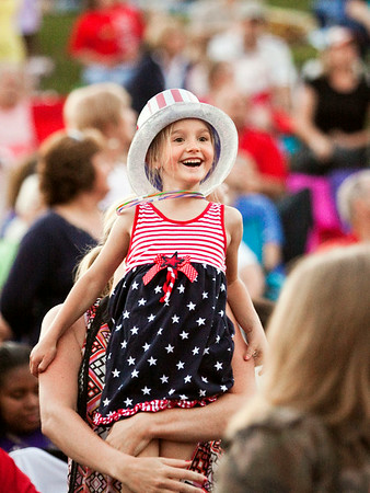 Dara Allen, 6, Edwardsville, looks on as the Louisville Crashers perform during the Independence Day Celebration at the New Albany Riverfront Amphitheater on Thursday evening. Staff photo by Christopher Fryer
