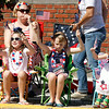 Riley Roberts, Lily and Ada Morrill wave flags during Jeffersonville's Celebrating Freedom Parade on July 4. After the parade down Spring Street, attendees went to Warder Park for a program with veterans, commemorating the holiday. Staff photo by Jerod Clapp