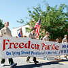 Members of Jeffersonville's Boy Scouts Troop 1 march down Spring Street in Jeffersonville on July 4. After the parade, attendees went to Wader Park for a commemorative program. Staff photo by Jerod Clapp