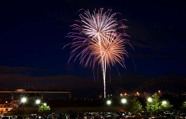 Fireworks explode over the Ohio River during the Independence Day Celebration at the New Albany Riverfront Amphitheater on Thursday evening. Staff photo by Christopher Fryer