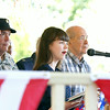 Madelyn Steurer sings the national anthem at the Jeffersonville Celebrating Freedom program on at July 4 at Warder Park. Behind her are war veterans who served from World War II to Desert Storm. Staff photo by Jerod Clapp