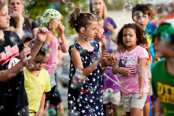 Children play in bubbles during the Independence Day Celebration at the New Albany Riverfront Amphitheater on Thursday evening. Staff photo by Christopher Fryer