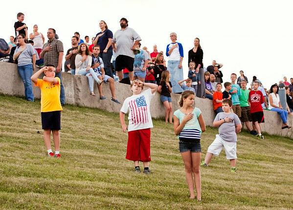"Attendees face the American flag while the ""Star Spangled Banner"" is played during the Independence Day Celebration at the New Albany Riverfront Amphitheater on Thursday evening. Staff photo by Christopher Fryer"