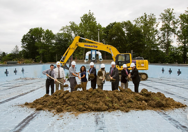 Local government and community leaders break ground during a ceremony at the site of the new aquatic center along Daisy Lane on the site of the former Camille Wright Pool in New Albany on Monday morning. Staff photo by Christopher Fryer