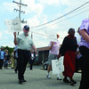 Community members participate in a recreation of the 1963 march on Washington to celebrate the 50-year anniversary of the Civil Rights Act of 1964, at The Friends of Division Street ice cream social and presentation, Sunday. Photo by Aprile Rickert