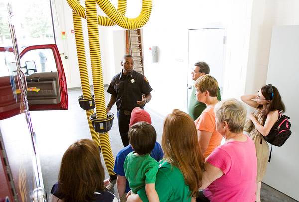 Firefighter Madell Peters discusses the features of an exhaust ventilation system as he leads a tour of the New Albany Fire Department's new station along Daisy Lane in New Albany during the grand opening of the facility Monday evening. Staff photo by Christopher Fryer