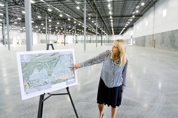 Managing Director Debbie Smith, with America Place in Jeffersonville and River Ridge, speaks during a press conference inside building one of the company's River Ridge campus along Trey Street on Monday morning. An automotive parts supplier is scheduled to be the first tenant on the property. Staff photo by Christopher Fryer
