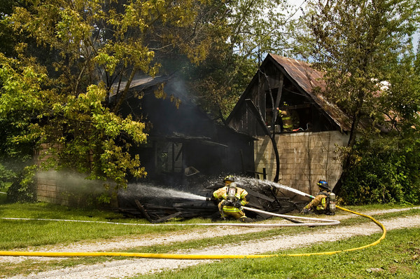 Firefighters work the scene of a barn fire that started just before 3 p.m. on Monday at the corner of U.S. 150 and Featheringill Road in Galena. No one was injured during the blaze and the cause is still under investigation. The Greenville Township, Georgetown Township and Lafayette Township fire departments all responded to the fire. Staff photo by Christopher Fryer