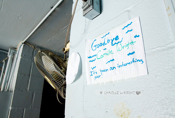 A farewell note hangs in what used to be the office of the former Camille Wright Pool at the site of the new aquatic center along Daisy Lane in New Albany on Monday morning. Staff photo by Christopher Fryer