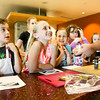 Participants look on as instructor Michael Cowan demonstrates how to prep a Korean dakkochi dish during the cooking course at Ivy Tech's Kids' College in Sellersburg on Monday morning. Staff photo by Christopher Fryer