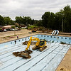 Keith Ponto, with Bryan Stumler Excavating, works to demolish the old facilities of the former Camille Wright Pool at the site of the new aquatic center along Daisy Lane in New Albany on Monday morning. Staff photo by Christopher Fryer