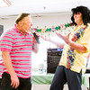 Bill Davis, left, and Charlie Wyzard perform druing a karaoke show for seniors at Clark Rehabilitation and Skilled Nursing Center in Clarksville earlier this year. Billed as Fun Karaoke with Bill and the Wiz the two perform, and free up the microphone for others to sing, at local nursing homes. Staff photo by Christopher Fryer