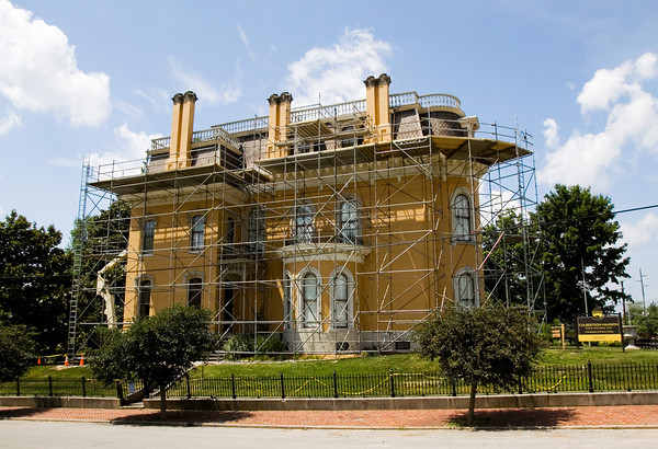 Scaffolding is pictured next to the Culbertson Mansion State Historic Site, located along Main Street in New Albany. Roofers are currently working to replace the slate part of the roof on the mansion that dates back to 1869. Staff photo by Christopher Fryer