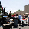 Jim O'Higgins, Fisherville, Ky, The Barbecue Cowboy, serves lunch to attendees at the annual Floyd Memorial Cancer Center's Survivors Day Celebration in New Albany on Friday afternoon. Staff photo by Christopher Fryer