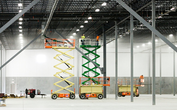 Construction crews work on the interior of building one at America Place's River Ridge campus located along Trey Street in Jeffersonville on Monday morning. An automotive parts supplier is scheduled to be the first tenant on the property. Staff photo by Christopher Fryer
