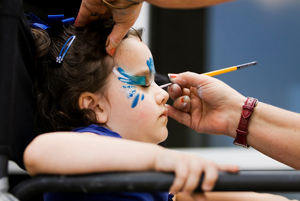 Emerson Schindler, 4, Louisville, sits for a face painting during the annual Floyd Memorial Cancer Center's Survivors Day Celebration in New Albany on Friday afternoon. Staff photo by Christopher Fryer