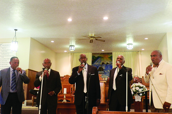 The Spiritual Wonders perform Sunday at the Howard Chapel Baptist Church on Market Street in New Albany, part of a celebration for the 50-year anniversary of the Civil Rights Act of 1964. Photo by Aprile Rickert