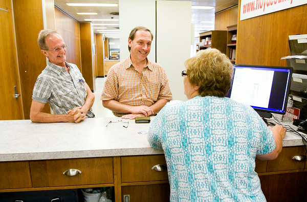 Lane Stumler, left, and Michael Drury, both of New Albany, talk with Floyd County Marriage Clerk Susie Tanksley, New Albany, while they apply for a marriage license at the City-County Building in downtown New Albany on Thursday morning. They were the seventh same-sex couple to obtain a marriage license in Floyd County following U.S. District Judge Richard Young's ruling on Wednesday that Indiana's ban on gay marriage was unconstitutional. Stumler and Drury plan to wed on July 24, which will mark their 10th anniversary as a couple. Staff photo by Christopher Fryer
